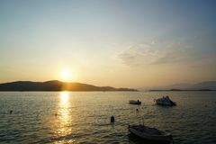The evening time when daylight disappeared in Fethiye and the boats on the beach stock photo