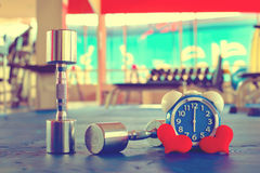 Time for exercising alarm clock and dumbbell the Gym background. Share Time Healthy Concept Royalty Free Stock Photography