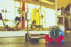 Time for exercising alarm clock and dumbbell the Gym background. Share Time Healthy Concept Royalty Free Stock Images