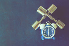 Time for exercising alarm clock and dumbbell the Gym background. Share Time Healthy Concept Royalty Free Stock Photos