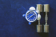 Time for exercising alarm clock and dumbbell the Gym background. Share Time Healthy Concept Royalty Free Stock Image