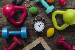 Time for exercising clock and fitness equipment Royalty Free Stock Photography