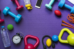 Time for exercising clock and sport equipment with yoga mat back Stock Photography