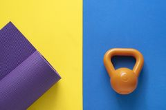 Time for exercising sport equipment concept with yoga mat and ke Royalty Free Stock Photo