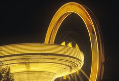 Time Exposure Ferris Wheel and Merry Go Round, Niagara Falls, New York Royalty Free Stock Photos