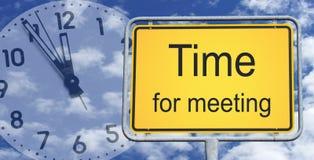 Time för möte av tecknet och av klockan Arkivbilder