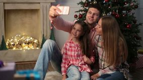 Time for family selfie on Christmas eve at home stock video