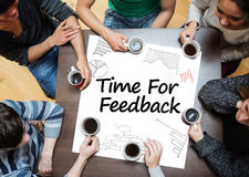 Time for feedback written on a poster with drawings of charts Stock Photo