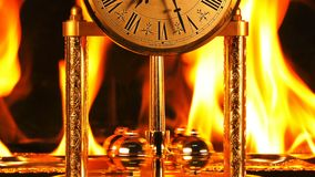 Time on fire burning hours. Vintage clock is burning stock video
