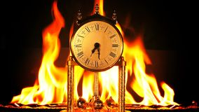 Time on fire burning hours. Vintage clock is burning stock video footage