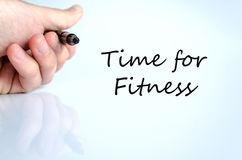 Time for fitness concept. Pen in the hand  over white background Time for fitness concept Stock Images