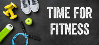 Time for Fitness. Fitness equipment on a dark background - Time for Fitness stock photography