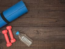 Fitness time, everything is ready for a good workout. Time fitness- water bottle, rug and dumbbells. Ahead of class training Stock Photography