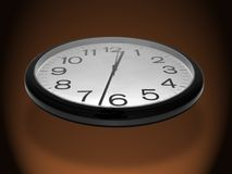 Time Flies. A photo of a clock flying through the air. A 'time flies' theme Stock Photo