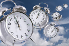 Time flies. Time flying concept - alarm clocks disappearing into the distance royalty free stock photo