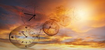 Time flies. Clocks in bright sky. Time flies stock images