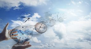 Time flies. Hands and clocks in sky Stock Images