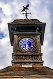 Time Flies, Very old Clock, outdoors on a rainy day. Time Flies, Very old Clock outdoors on a rainy day stock photo