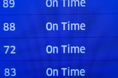 On time fllight status. Close up of airport status board with On Time departures Stock Photos