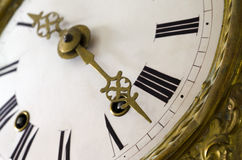 Almost Time. Focus on tips of hand with strong depth of field on an antique watch Stock Photo