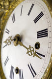 Almost Time. Focus on tips of hand with strong depth of field on an antique watch Stock Photography