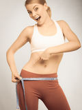 Time For Diet Weight Loss. Fit Girl Measuring Her Hips. Royalty Free Stock Photography