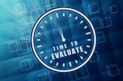 Time For Evaluate In Clock Symbol In Blue Glass Cubes Royalty Free Stock Image