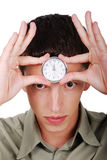 Time on forhead. Young model is holding watch on his forhead Royalty Free Stock Image