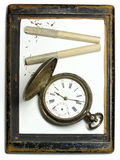 Time in frame. Vintage silver clock, old cigarette in the retro frame Stock Photography