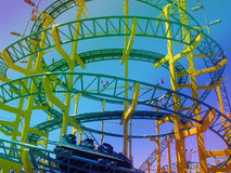 Time of fun. Roller coaster on multicolor light stock image