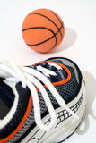 Time for game !. Sport shoe and a basketball Royalty Free Stock Photography