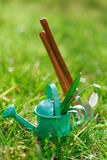 Time for garden now�. decorative small gardening tools and sno Royalty Free Stock Image