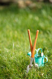 Time for garden now�. decorative small gardening tools Royalty Free Stock Photography