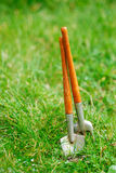 Time for garden now…. decorative small gardening tools and sno Royalty Free Stock Photography