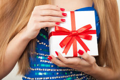 Time gifts. Gift box in the hands of a young girl. Royalty Free Stock Photography