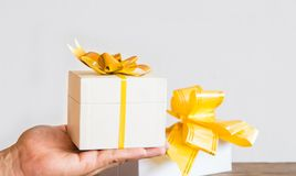 The Time gifts,white gift box in hand on wood table stock photo