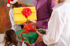 Time of giving Christmas presents Stock Images