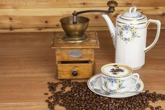 Time for a good aromatic coffee. Coffee on a wooden table. Preparing for home drinking coffee. Royalty Free Stock Images