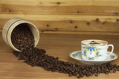 Time for a good aromatic coffee. Coffee on a wooden table. Preparing for home drinking coffee. Royalty Free Stock Image
