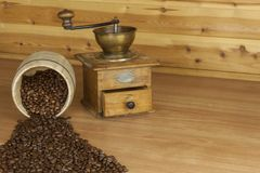 Time for a good aromatic coffee. Coffee on a wooden table. Preparing for home drinking coffee. Royalty Free Stock Photos