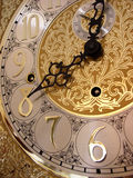 Time on a grandfather clock. 's gold face Stock Photography