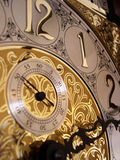 Time on a grandfather clock. 's gold face Royalty Free Stock Images