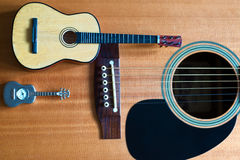 Three guitars together. A concept of 3 guitars next to each other Stock Photography