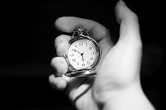Time. Hand holding a silver watch Stock Images