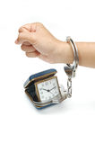 Time in handcuffs. A hand in handcuffs in time Stock Photos
