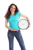 On time happy brunette woman with large clock Royalty Free Stock Photos
