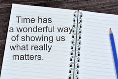 Time has a wonderful way of showing us what really matters on notebook Royalty Free Stock Images
