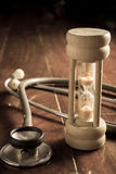 Time for health,stethoscope with hourglass Royalty Free Stock Photo