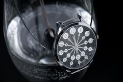 Time and hours in a broken glass of water. time passes like water