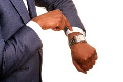 Time. Image of a businessman checking the time with a white background Stock Photo